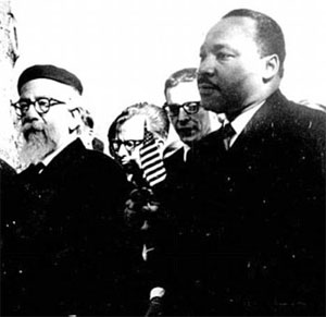 The Rev. Dr. Martin Luther King, Jr. and Rabbi Abraham Joshua Heschel Marching together In Selma